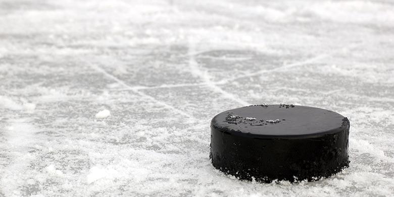 black hockey puck on ice