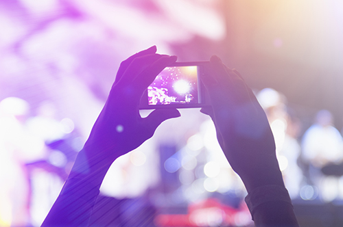 Photographing with cell phone at the concert