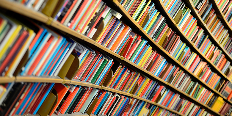 textbooks lined up on a bookshelf
