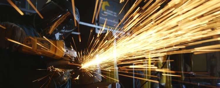 person using welding machine, sparks flying