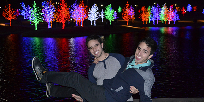 The Chiquini brothers, home for the holidays, visit the Vitruvian Lights display near Brookhaven College.
