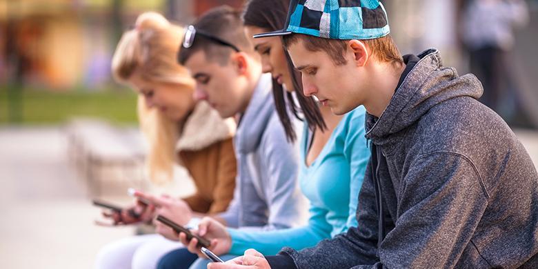 Teenagers Using Phones