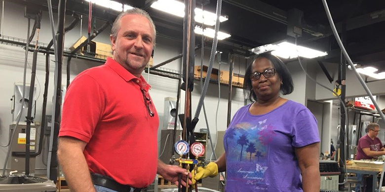 Student Valerie Handley with instructor Loren Hines at Cedar Valley College.