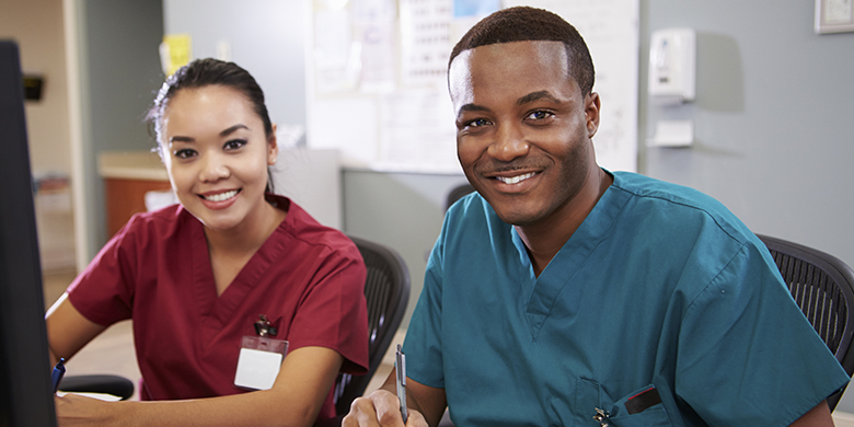 man and woman in scrubs