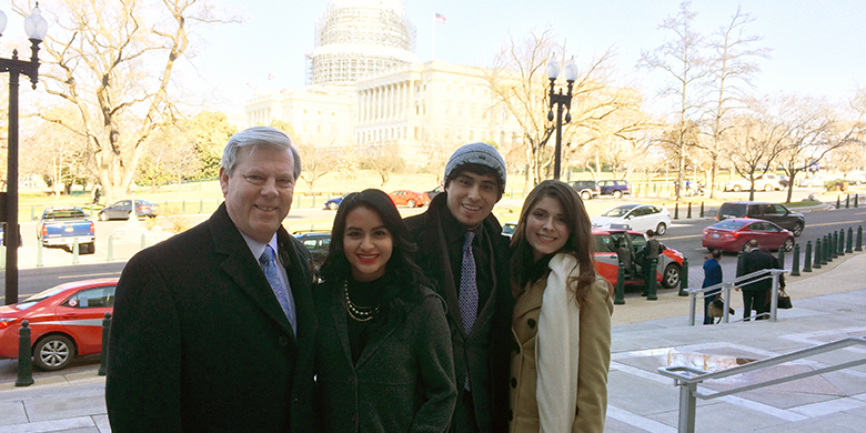 Chancellor May and students Dragana, Eian and Fabiola standing together in Washington, DC.