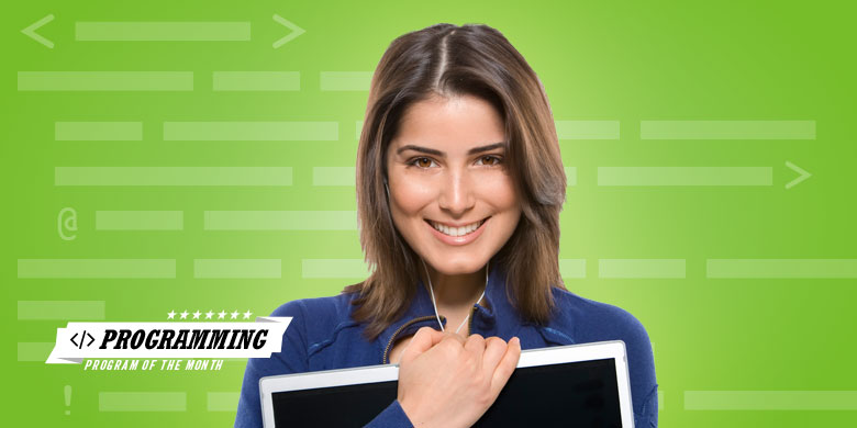 woman smiling, holding laptop computer