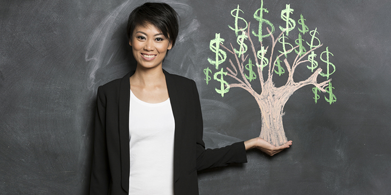 woman and chalk money tree drawing on blackboard
