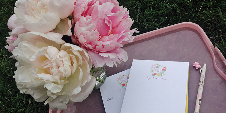 Peonies and a notepad