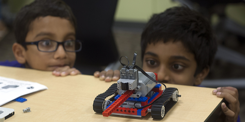 Kids at a North Lake summer camp learn about Legos.