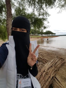 Sadiya snaps a quick selfie by the lake while other students go for a swim.