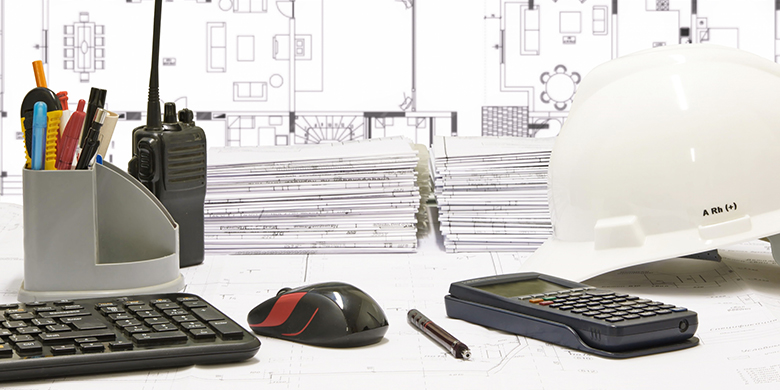 Basic instruments of a construction engineer on worktable