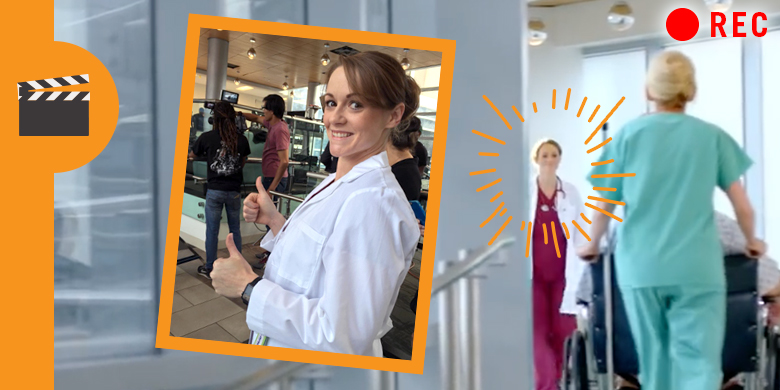 Mallory on set of DCCCD ad. Picture of Mallory in lab coat smiling and another nurse walking in background.