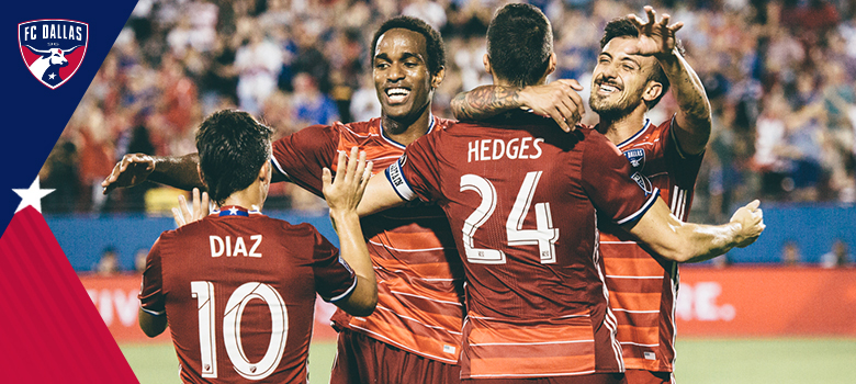 FC Dallas soccer players celebrate, hug