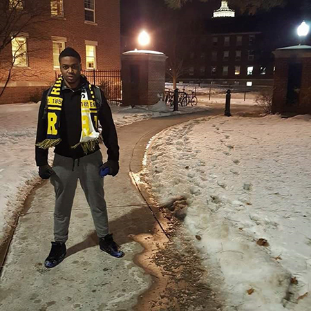 William Kaseu, El Centro graduate, standing on the snowy campus at University of Rochester.