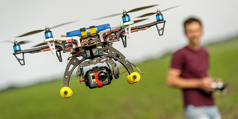 man learns to fly a drone