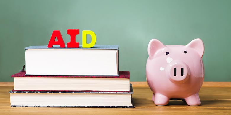 Student aid theme with textbooks and piggy bank and chalkboard background