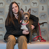 Courtney Gustafson sits with her dog.
