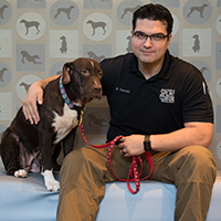 Dave Fuentes sits with his dog.