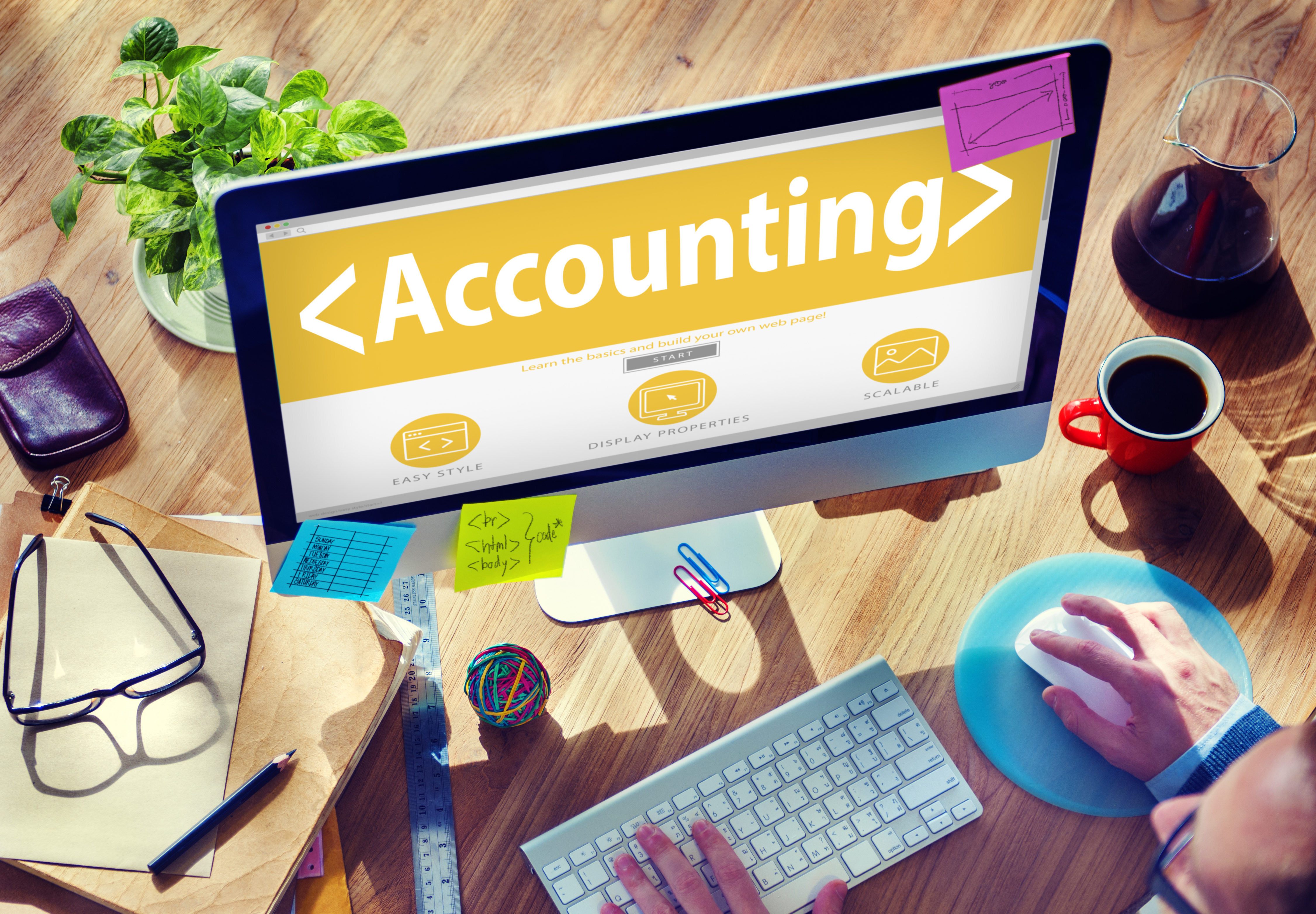 Computer screen with the word accounting appearing on screen with keyboard.