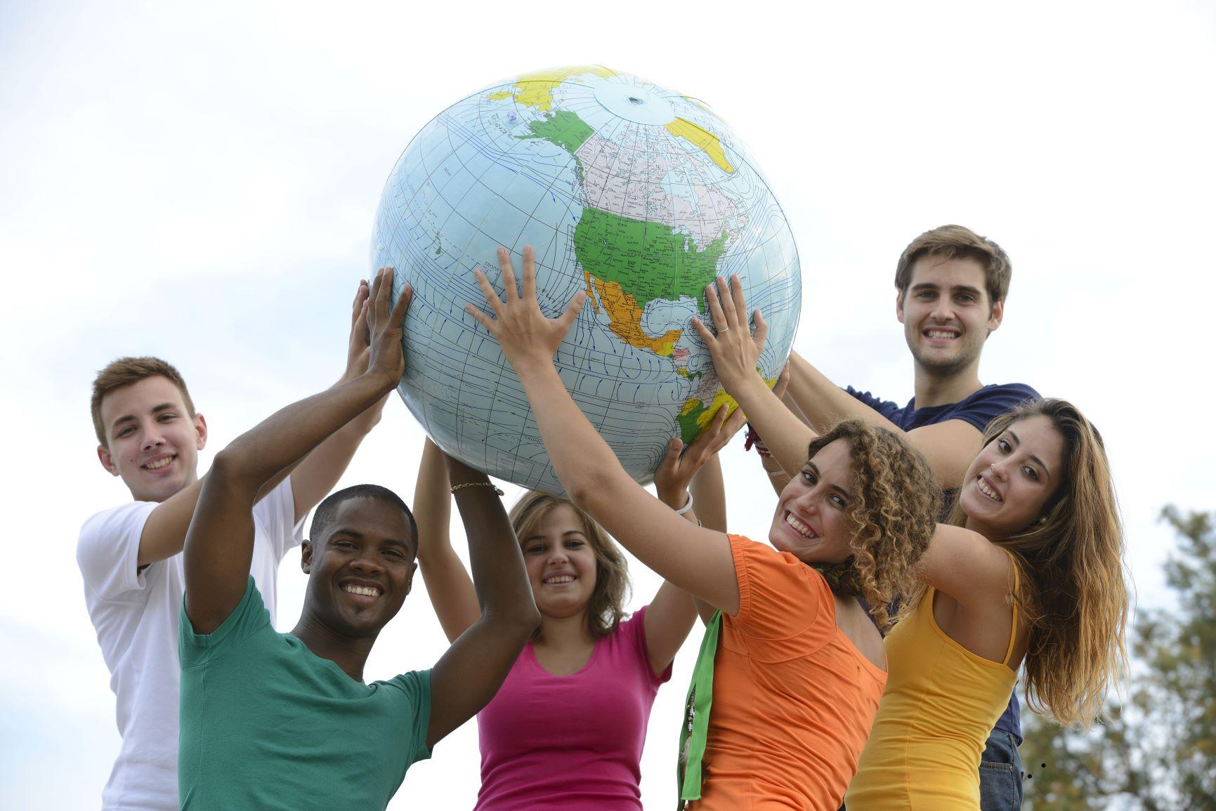students holding globe