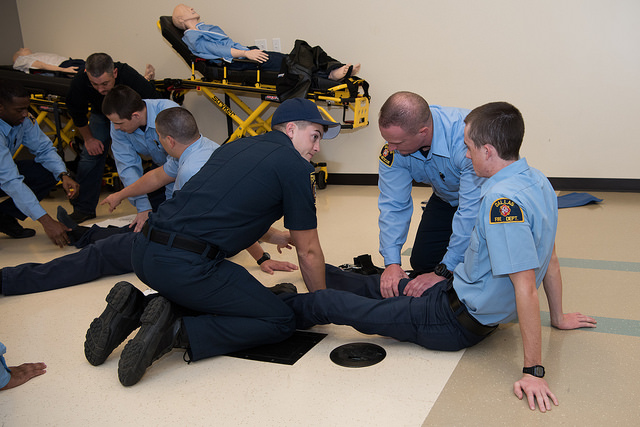 DCCCD EMT and paramedic students in class, practicing techniques.