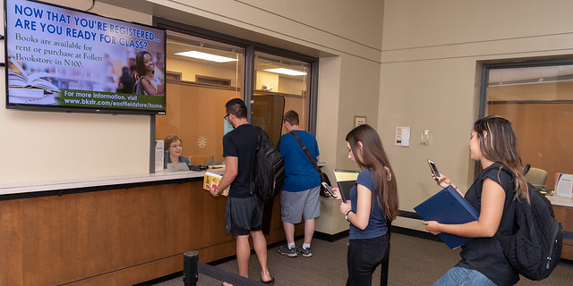 DCCCD students standing in line to pay for classes.