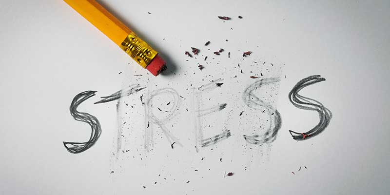 "Illustration showing the word ""stress"" being erased."
